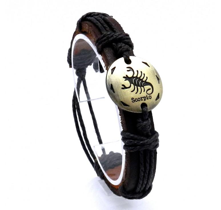 Мужской кожаный плетеный браслет со вставкой со знаком зодиака Скорпион. Размер регулируется цвет коричневый